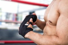 Male fighter wear bandages on fist. muscular man bind bandage on Royalty Free Stock Image