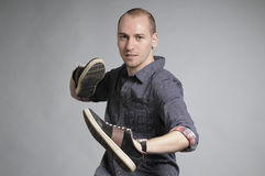 Male fighting with shoes Stock Photos