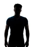 Male figure in silhouette looking at the camera. Isolated on white background Stock Images