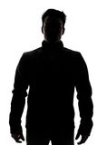 Male figure in silhouette wearing a vest. Isolated on white background Royalty Free Stock Images