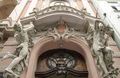 Male figures sculptures. On the facade of an old house in Art Nouveau style, Lviv, Ukraine stock photography