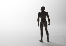 Male figurine silhouette standing in powerful pose looking to th Stock Image