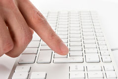 Male finger pressing computer keys Stock Images