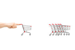 A male finger pushing a cart towards others Stock Photos