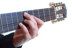 Male fingers playing the guitar Stock Photo