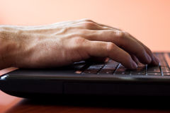 Male fingers typing a business document on the black laptop Royalty Free Stock Photo
