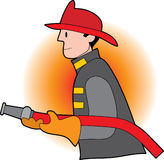 Male firefighter. Holding a fire hose and wearing a helmet Stock Photos