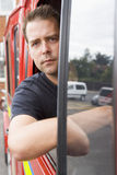 Male firefighter sitting in the cab Royalty Free Stock Photography
