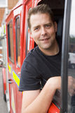 Male firefighter sitting in the cab Stock Image
