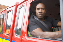 Male firefighter sitting in the cab Stock Photos