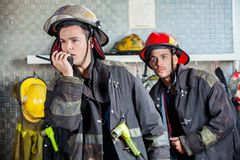 Male Firefighter Using Walkie Talkie With Royalty Free Stock Images