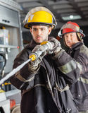 Male Firefighters Spraying Water During Training Stock Photography