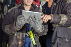 Male Firefighters Using Digital Tablet Stock Photo
