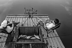 Male fishing vacation. Father and son with catch stock image