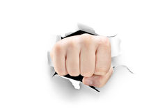 Male fist breaking through a white paper Royalty Free Stock Photos