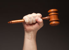 Male Fist Holding Wooden Gavel Royalty Free Stock Images