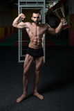 Male Fitness Competitor Showing His Winning Medal. Bodybuilder Competitor Showing His Winning Medal - Male Fitness Competitor Showing His Winning Medal Stock Photos