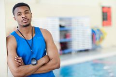 Male Fitness Instructor in Swimming Pool. Waist up African-American fitness instructor posing with arms crossed in swimming pool, copy space royalty free stock photos