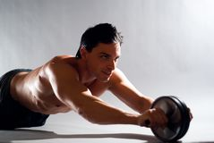 Male fitness model. A fit, sexy, young male model on a simple background Royalty Free Stock Image