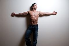 Male fitness model. A fit, sexy, young male model on a simple background Stock Image