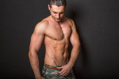 Male fitness model on black background Royalty Free Stock Image