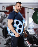 Male fitness model in the gym Royalty Free Stock Image