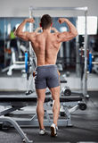 Male fitness model in the gym Royalty Free Stock Photos