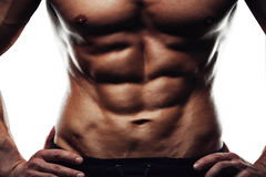 Male fitness model showing sixpack abdominal Stock Photos