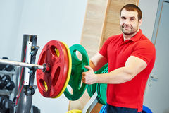 Male fitness trainer at gym Royalty Free Stock Photo