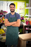 Male florist with arms crossed in his flower shop Stock Photo