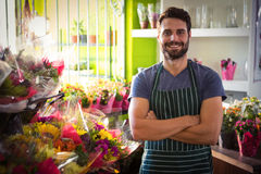 Male florist with arms crossed at his flower shop Stock Photography