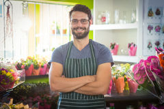 Male florist with arms crossed at his flower shop Stock Image