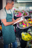 Male florist checking checklist Royalty Free Stock Photography