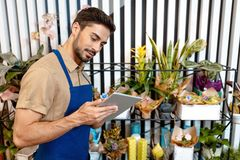 Male florist with digital tablet Royalty Free Stock Images