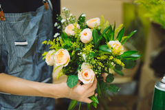 Male florist making beautiful bouquet at flower shop Royalty Free Stock Photos