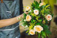 Male florist making beautiful bouquet at flower shop Stock Images
