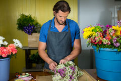 Male florist preparing a flower bouquet Royalty Free Stock Photo