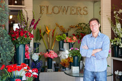 Male Florist standing outside flower shop Stock Photography