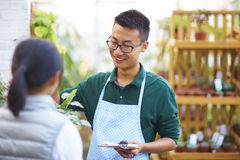 Male Florist Talking to his Customer in the shop Royalty Free Stock Image