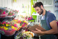 Male florist writing and making notes Royalty Free Stock Photography