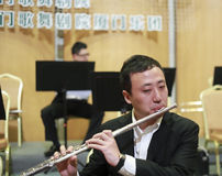 Male flute musician practicing before the show. Southern fujian symphony concerts in xiamen dance theater, amoy city, china. 2014-2-28 Royalty Free Stock Photo
