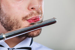 Male flutist playing his flute closeup Royalty Free Stock Images