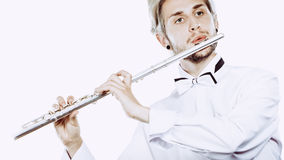 Male flutist playing his flute Royalty Free Stock Photo