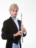 Male flutist wearing tailcoat holds flute Royalty Free Stock Photography