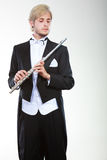 Male flutist wearing tailcoat holds flute Royalty Free Stock Photos