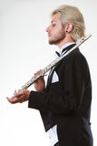 Male flutist wearing tailcoat holds flute Stock Image