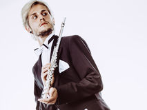 Male flutist wearing tailcoat holds flute Royalty Free Stock Image