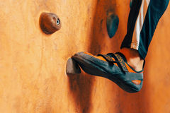 Male foot on climbing wall Royalty Free Stock Image
