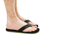 Male foot in flip-flop Stock Images