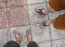 Male foot with flip flop shoes stock images